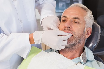 Dentist examines a patient's teeth