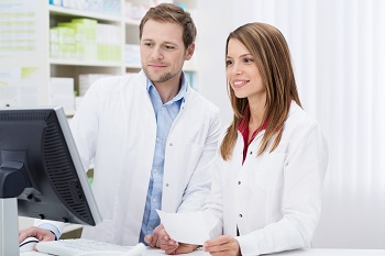 A pharmacist mentoring a new pharmacist